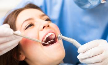 girl in chair getting exam at pillar dental
